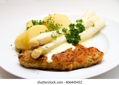White Asparagus with beef cutlet and potatoes