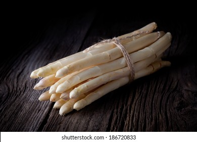 White asparagus bunch. Fresh vegetables tied with a string taken on white background.