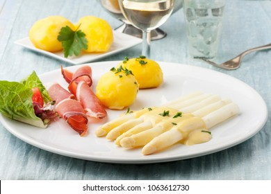 white asparagus with ham on a plate