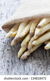 white asparagus on wooden background