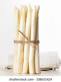 white asparagus on wooden table