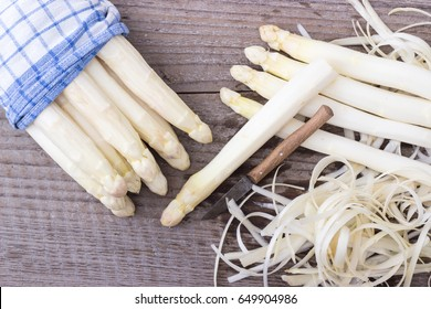 White asparagus is peeled with a knife