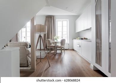 White attic apartment interior with shabby chic furniture