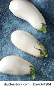 White aubergines on the wooden background
