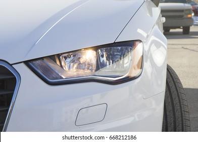White Audi car headlight, beam