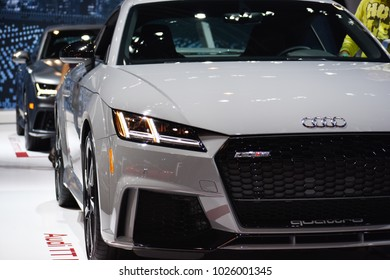 White Audi TT 2018 Chicago Auto Show Black in the background looks like it coming at you