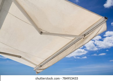 white awning against blue sky