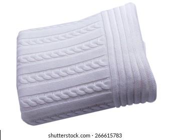 White baby blanket folded and isolated on white background