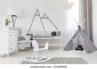 White baby room with cockhorse and crib