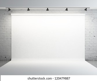 White backdrop in room with grey paint on wall