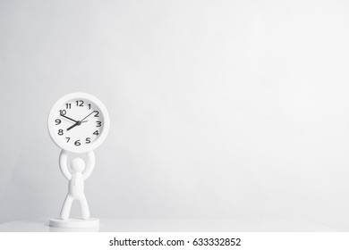 White background with white alarm clock on table