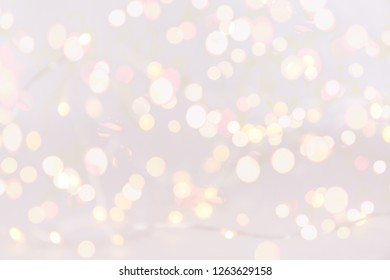 White background with bokeh lights. Holiday Christmas and New Year background. Horizontal, bright lights bokeh background
