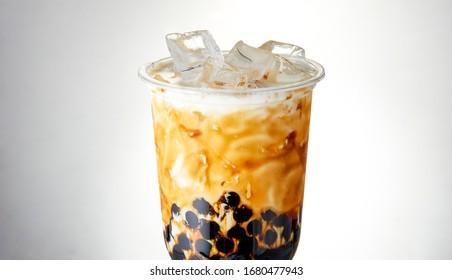 White background of chocolate pearl milk tea