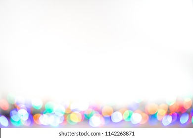 White background with colored soft lights along bottom border