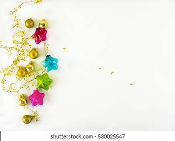 White background with colorful christmas spheres and stars and space for copy.