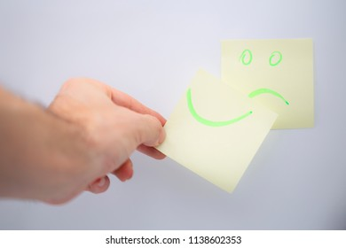 in the white background and empty space the smile in the memo  like concept of emotions and hands