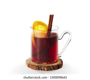 white background. mulled wine on a wooden coaster