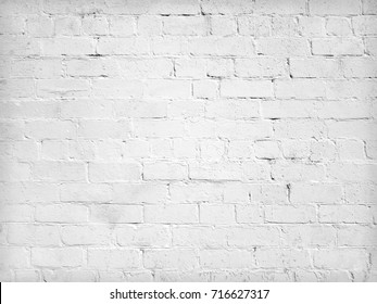 White background of old brick wall texture with delicate vignetting.