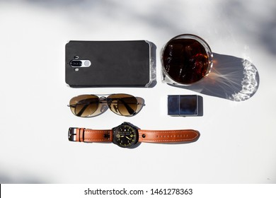 white background on coffee , smarthphone , sunglasses , vintage watch and lighter