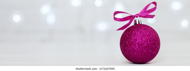 white background. pink ball. Banner for the site. The concept of Christmas and New Year.