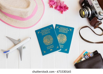 White background, Travel, airplane, camera, straw hat, purse with bank cards and money, top view.