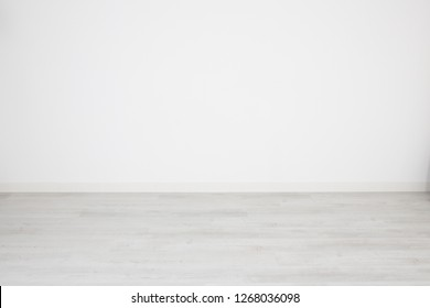 for white background or wallpaper bleached parquet floor and blank white wall