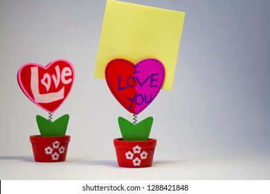 White background. Wooden hearts with clothespegs for stickers on a spring. Congratulation. Invitation. St. Valentine's Day. A decor for the house. Blank space of day of an inscription.