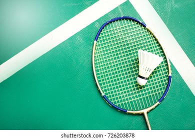 White badminton shuttlecock on a green floor at  badminton courts .Close up shuttlecocks on racket badminton at badminton courts