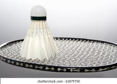 White badminton shuttlecock on the racket