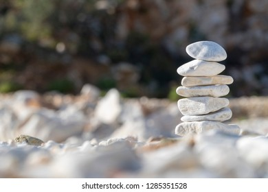 white balanced and stacked strones at the beach in sunny day