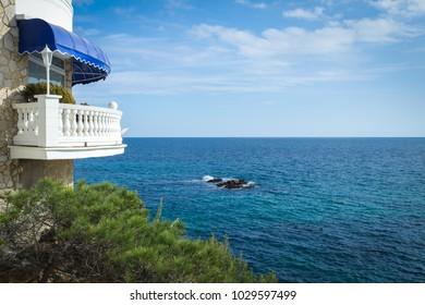 a white balcony above the Mediterranean Sea