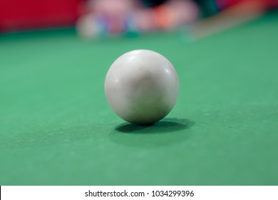 White ball on billiard table