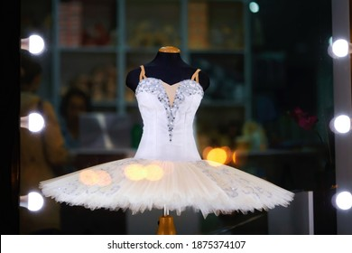 White ballet tutu on display in ballet store accessory. Showcase of ballet accessories shop, professional tutu and costume