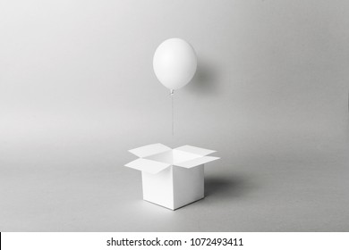 white balloon flying out of magic little box