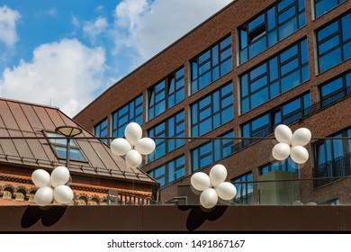 white balloons on a balustrade