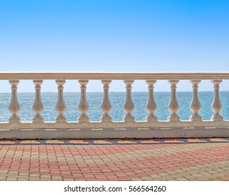 White baluster overlooking sea horizon