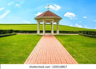 white bandstand or gazebo in the garden , wedding pavilion