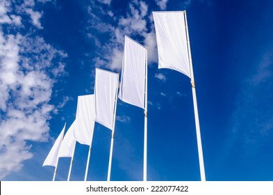 White banner. Some white ad banners waving on the sky