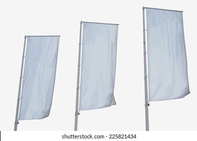 White banner. Tree empty vertical banners isolated. Blank space for write at your own. White flag isolated
