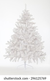 White bare Christmas tree without decoration  on white background