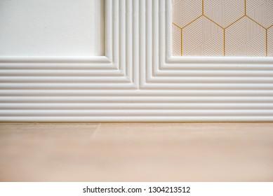 White baseboard, geometry plinth, skirting inside room, washboard, trim. Modern interior design concept