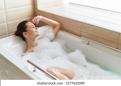 White bath foam beautiful woman model relaxing