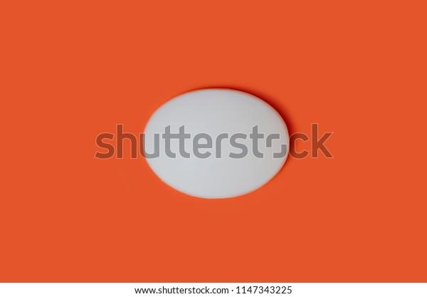 White bath soap isolated on orange background.
