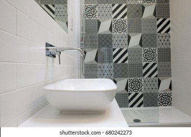 White bathroom with monochrome patchwork tiles