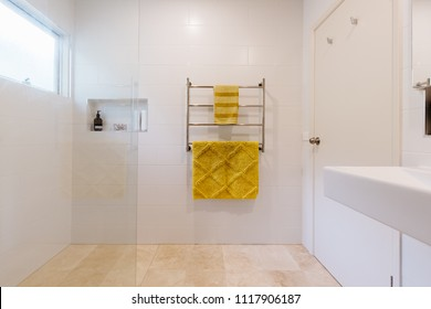 White bathroom with mustard yellow accent towels