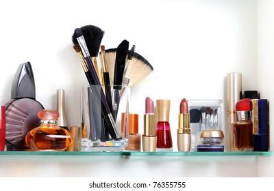 white bathroom shelf with cosmetics and  toiletries