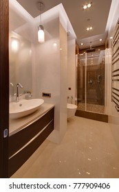 A white bathroom with a shower cabin and white walls