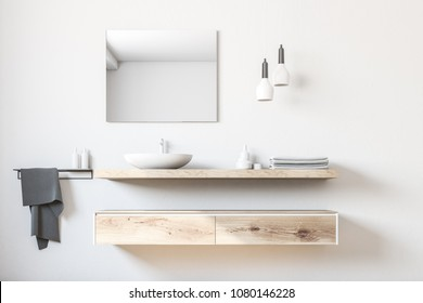 White bathroom sink standing on a wooden shelf. A square mirror hanging on a white wall. 3d rendering