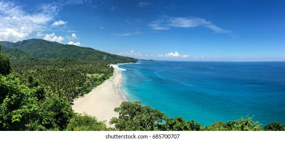 White beach and blue sea in Lombok Island, Indonesia. Lying to the east of Bali, Lombok is the quieter and less developed alternative to its more famous neighbour.