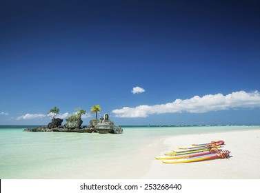white beach and christian shrine and paddle boats on boracay tropical island in philippines asia
